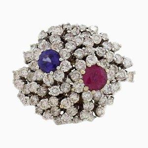 Anello con diamanti, zaffiri, rubini e oro 18 Kt