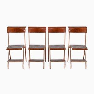 Sillas plegables de metal y madera, años 50. Juego de 4