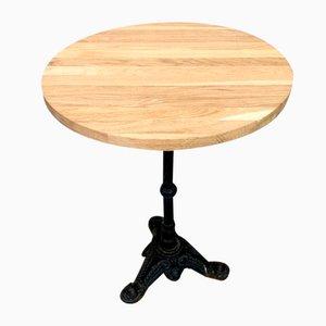 Tavolo da bistrò in legno di quercia massiccio e ghisa
