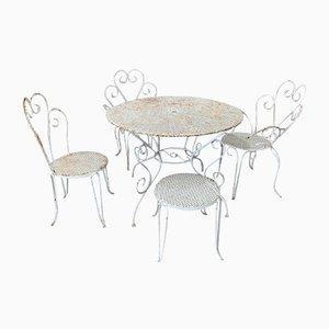 Mesa de jardín circular de metal blanco con sillas. Juego de 5