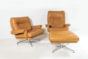 Mid-Century Tan Leather Swivel Chairs with Footstool on Chrome Base from Howard Keith, 1960s, Set of 2