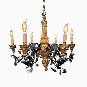 Lampadario in legno dorato, ferro battuto e porcellana, fine XIX secolo