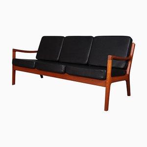 Sofá modelo Senator con asiento de caña de Ole Wanscher para Cado