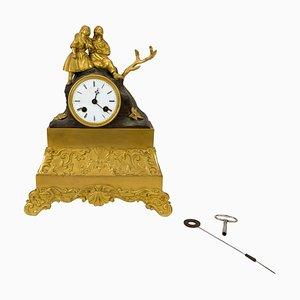 Reloj de chimenea francés de bronce dorado, década de 1820
