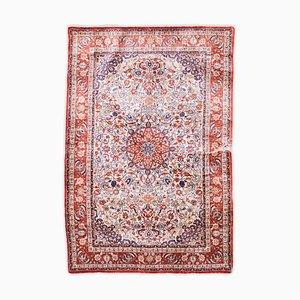 Tappeto floreale in pura seta rosso scuro con bordo e medaglione