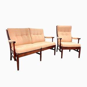 Sofá de dos plazas y silla vintage en rosa salmón. Juego de 2