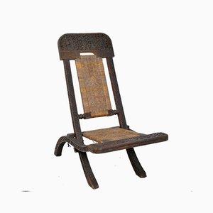 Antiker asiatischer Klappstuhl aus geschnitztem exotischem Holz & Cannage