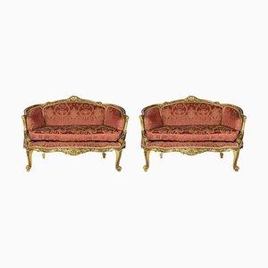 Sofás de dos plazas franceses de madera dorada. Juego de 2