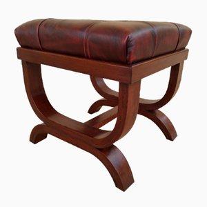 Puf o taburete con asiento acolchado