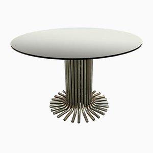 Tavolo in vetro con base in acciaio di Gastone Rinaldi