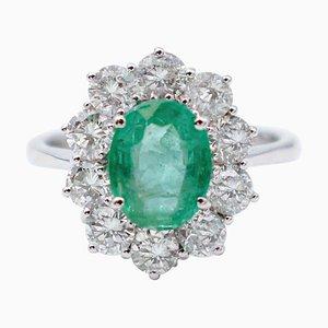 Anello moderno in oro bianco con smeraldo, diamanti e 18 carati