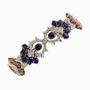 Brazalete de eslabones de diamantes blancos, zafiros azules, rubíes y oro blanco