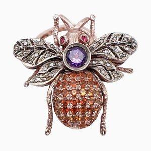 Anillo en forma de mosca de diamantes, amatistas, rubíes, piedras de colores, oro rosa de 9 quilates y plata
