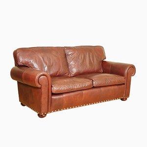 Sofá de dos plazas marrón