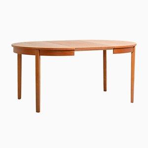 Mesa extensible y redonda de teca