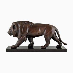 Escultura estilo Art Déco de Max Le Verrier, león andante, metal patinado y mármol