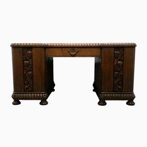 20th Century Oak Desk with Grape and Vine Leaf Carvings & Sliding Shelves