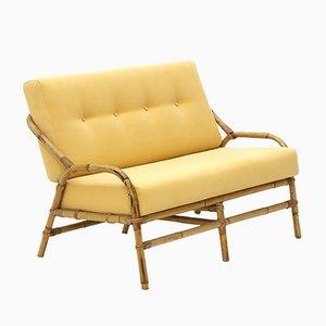 Sofá de ratán con relleno de tela amarilla, años 60