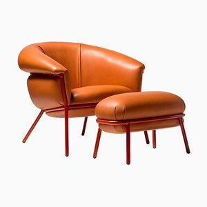 Grasso Orange Leather Armchair and Footstool by Stephen Burks, Set of 2