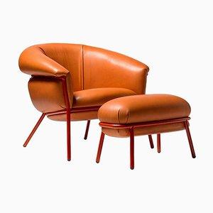 Grasso Sessel & Fußhocker aus orangefarbenem Leder von Stephen Burks, 2er Set