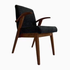 Black Armchair by Mieczyslaw Puchala