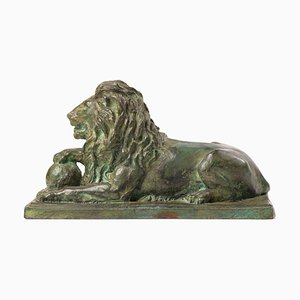 Reclining Lion with Paw on Orb, France, Early 20th-Century, Bronze