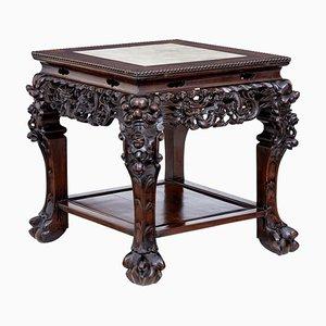 Chinesischer Tisch aus geschnitztem Hartholz mit Marmorplatte, 19. Jh