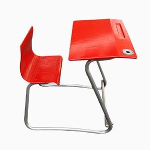 Banco scolastico rosso con sedia, anni '50