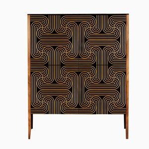 Mueble dorado con bucles de cuatro puertas de Coucou Manou