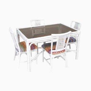 Juego de comedor de ratán blanco con cuatro sillas tapizadas con tela de Missoni