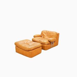 Cognacfarbener Vintage Sessel und Fußhocker von Dreipunkt International