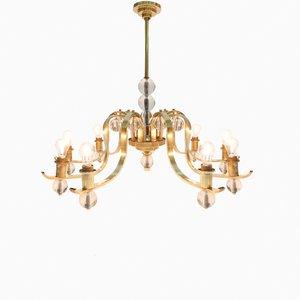 Lámpara de araña italiana de latón y vidrio de nueve brazos, años 60