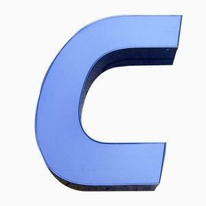 Letra C en azul de neón