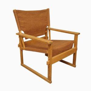 Dänischer Armlehnstuhl aus Braunem Leder und Eichenholz von Poul Hundevad, 1960er