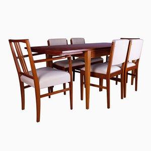 Mesa de comedor británica de madera de tulipán con sillas de Gordon Russell, años 60. Juego de 7