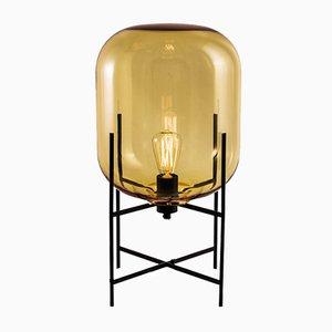 Lampada da terra Oda Small nera e ambra di Sebastian Herkner per Pulpo