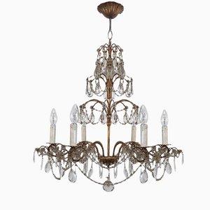 Lámpara de araña vintage de cristal y metal dorado