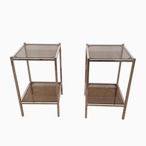 Mesas auxiliares vintage de metal y vidrio. Juego de 2