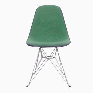 Silla de fibra de vidrio negra con tapizado verde de de Charles & Ray Eames para Herman Miller, años 70