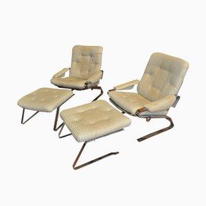 Französische Armlehnstühle aus Stahl mit Ottomanen, 1970er, 2er Set