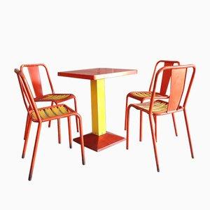 Juego de comedor industrial en naranja y amarillo de Xavier Pauchard para Tolix, años 50
