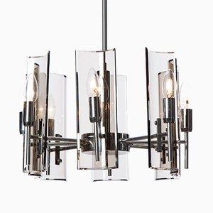 Lámpara de araña de cromo claro y vidrio de 8 luces de Crystal Arte, años 50