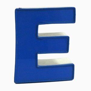 Letra E vintage en azul, años 70