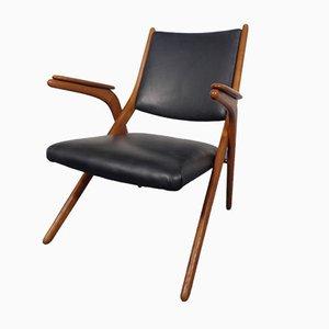 Silla Boomerang de cuero negro, años 60
