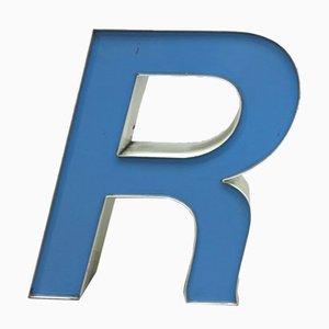 Letra R decorativa vintage en blanco y azul, años 70