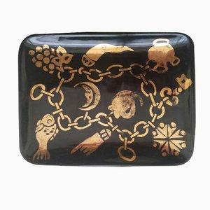 Piatto piccolo con braccialetto charm nero e oro di Piero Fornasetti, 1960