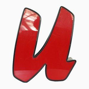 Letra U iluminada en rojo y negro
