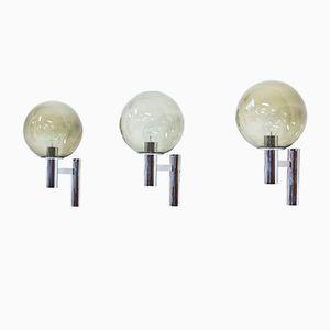 Lámparas de pared vintage de metal cromado y vidrio. Juego de 3
