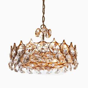 Lámpara de araña de latón dorado y cristal y siete luces de Palwa, años 60