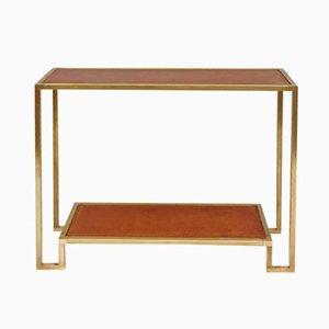 Consola vintage de latón dorado con superficie de cuero